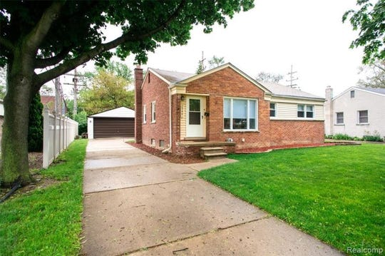 This three-bedroom Livonia house is listed for $165,000.