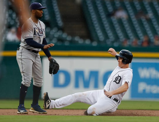 Detroit Tigers' Brandon Dixon slides into third base during the fourth inning against the Tampa Bay Rays on Wednesday, June 5, 2019, in Detroit.