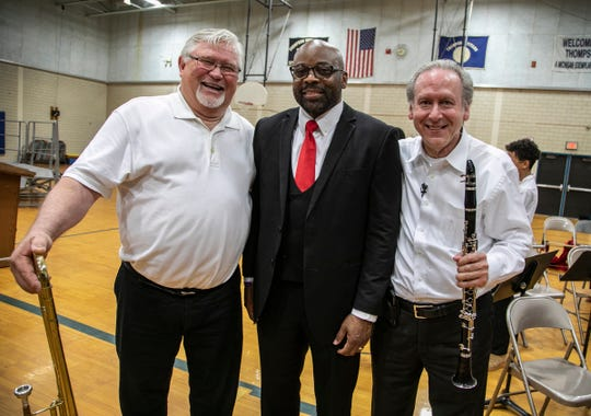 Former Charlevoix City Band director Gary Stutzman, left, poses with Thompson K-8 International Academy band director LaShawn Gary and  alumni Stephen Korn, together the three resurrected the schools fight song that was performed during their annual spring concert Thursday, May 30, 2019.