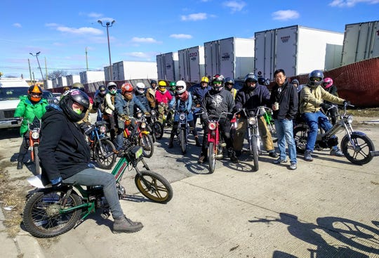 Members of southeast Michigan moped community gather for a ride in 2018.