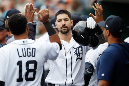 Tigers right fielder Nicholas Castellanos celebrates with teammates in the dugout after scoring a run during the first inning on Thursday, June 6, 2019, at Comerica Park.