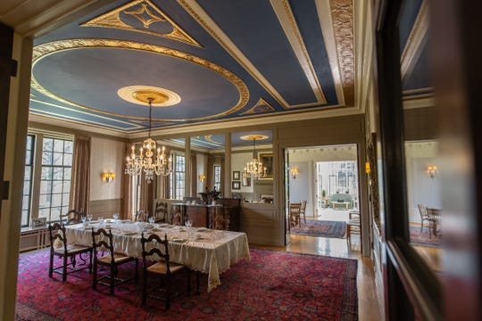 The elaborate ceiling of the formal dining room had collapsed when an upstairs tub overflowed. The owner used dentist's material to make molds of the intact parts, then artisans rebuilt the ceiling with its lavish plaster detailing and paint. Photographed in Detroit on Tuesday, June 4, 2019.