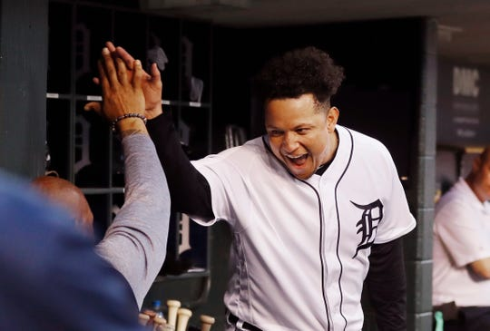 Detroit Tigers' Miguel Cabrera greets a teammate after hitting a grand slam during the fifth inning against the Tampa Bay Rays, Tuesday, June 4, 2019, in Detroit.