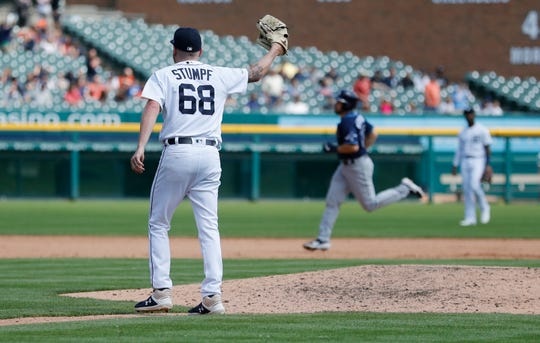 Detroit Tigers relief pitcher Daniel Stumpf walks back to the mound as Tampa Bay Rays' Travis d'Arnaud rounds the bases after hitting a two-run home run during the eighth inning.