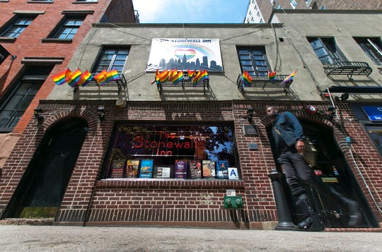 A man passes The Stonewall Inn in New York's Greenwich Village. The bar was the site of the Stonewall uprising that started on June 28, 1969 and galvanized the Gay Rights Movement.