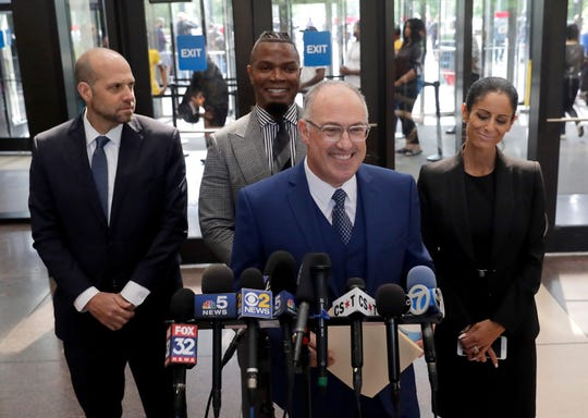 Steve Greenberg, R. Kelly's defense attorney, smiles as he responds to a question after Kelly pleaded not guilty on 11 new sex-related felonies Thursday, June 6, 2019, in Chicago.