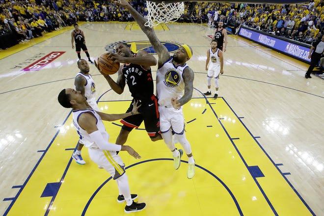 Toronto Raptors forward Kawhi Leonard (2) shoots between Golden State Warriors center DeMarcus Cousins (0) and Shaun Livingston during the second half.