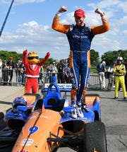 Driver Scott Dixon celebrates after winning the Dual II IndyCar Series Race at the Chevrolet Detroit Belle Isle Grand Prix on June 2.