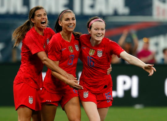 Alex Morgan, center, was ranked the No. 2 player in the World Cup by ESPN.