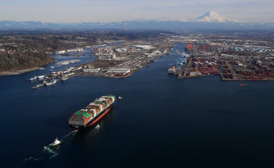 A cargo ship arrives at the Port of Tacoma, in Tacoma, Wash.