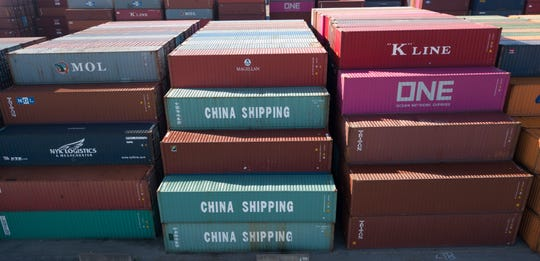 China Shipping Company containers are stacked at the Virginia International's terminal in Portsmouth, Va.