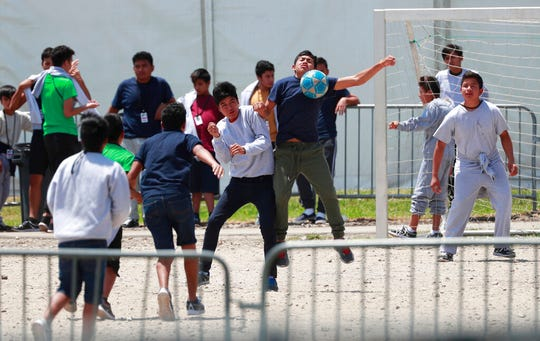 In this April 19, 2019 file photo, migrant children play soccer at the Homestead Temporary Shelter for Unaccompanied Children on Good Friday in Homestead, Fla. The government has stopped reimbursing some contracted shelters for the cost of teaching immigrant children English-language courses and providing legal services and recreational activities.