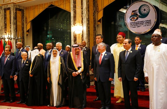 Leaders of Islamic countries pose for a group picture ahead of Islamic Summit of the Organization of Islamic Cooperation (OIC) in Mecca, Saudi Arabia, early Saturday, June 1, 2019. Muslim leaders from some 57 nations gathered in Islam's holiest city of Mecca late Friday to discuss a breadth of critical issues ranging from a spike in tensions in the Persian Gulf, to Palestinian statehood, the plight of Rohingya refugees and the growing threat of Islamophobia.