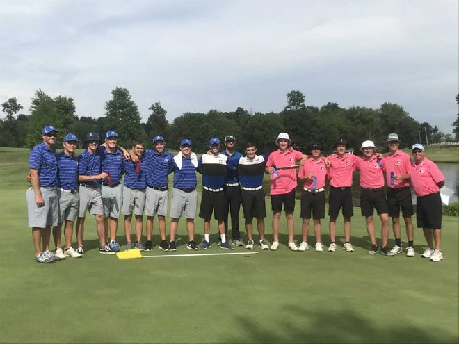 North, Castle and Memorial golfers celebrate on the 18th green at Country Oaks after advancing to the IHSAA state championship.