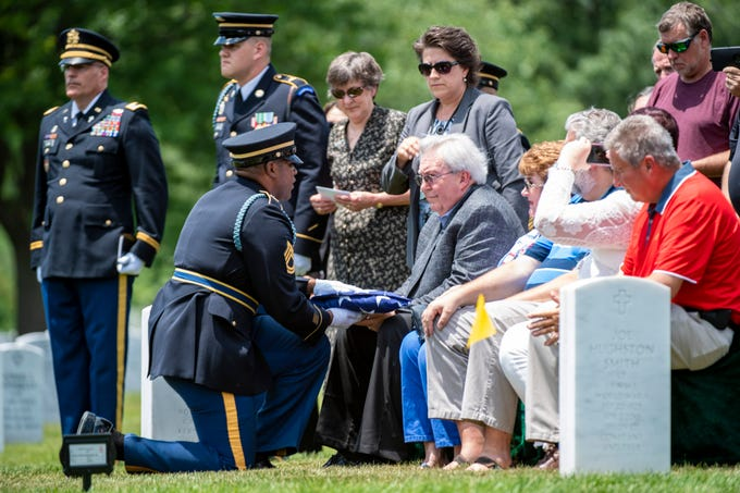 6/6/19 12:15:25 PM -- Arlington, VA, U.S.A  -- Carl Man II is presented with the flag during U.S. Army World War II veteran Carl Mann of Evansville, Ind., burial at Arlington National Cemetery on June 6, 2019 in Arlington, VA. For his service in World War II, Mann was awarded three Purple Hearts and seven Bronze Stars.  Mann died on March 30, 2019 at the age of 96. --   Photo by Jarrad Henderson, USA TODAY Staff ORG XMIT:  JH 138066 Arlington_Mann 6/6/2019 [Via MerlinFTP Drop]