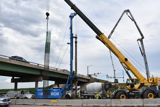 A crane lifts rebar mesh into place for construction of the new Prospect Road bridge at Interstate 25 on Monday.