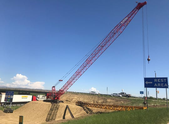 A crane works next to the Prospect Road bridge Wednesday. Construction on the bridge expansion started this week.