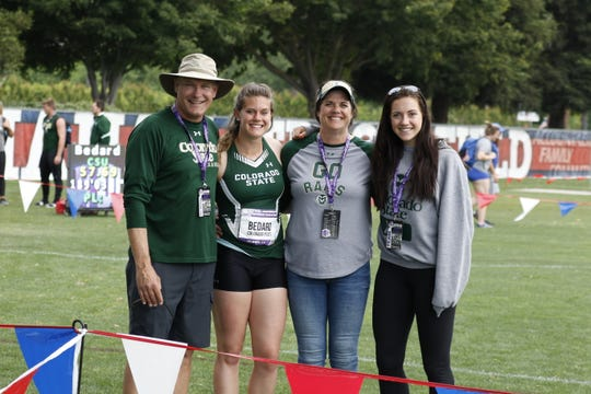 Colorado State University track and field coach Brian Bedard, daughter Kelcey, wife Jill and daughter Baylee pose for a picture at the Mountain West Outdoor Track and Field Championships last month in Clovis, Calif. Kelcey Bedard won a conference title in the hammer throw and the Rams swept the men's and women's team titles.
