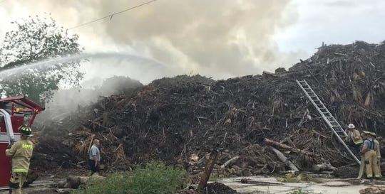 Fire in a pile of agricultural waste on a site operated by MW Horticultural in North Fort Myers in 2018. The piles of Hurricane Irma debris, originally about 35,000 cubic yards, are now at about 6,000 cubic yards.  Lee County, which had given the company until June 6 to emove the material, granted a one-month extension on Tuesday. If not cleared by July 5 the company faces $200 fines for every day the debris remains.