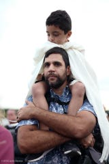 Why he fights: Vikram Chhabra, who's organizing Fort Myers' World Oceans Day celebration, with his son, Ethan