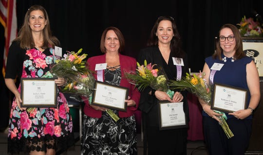 Kelly L. Fayer, left, Karen L. Mosteller, Julie Koester, Kathleen O. Berkey and Kerri A. Goldsmith, not pictured, are honored as finalists for the 2019 APEX Award on Wednesday at the Crowne Plaza Fort Myers at Bell Tower Shops. The Greater Fort Myers Chamber of Commerce's Women in Business Committee presents the award to Lee County residents who excel in professional achievement, community service/philanthropy, mentoring and leadership. Eleven additional women were honored as nominees. The winner will be announced on August 16 at the 14th Annual Apex Awards at The Westin Cape Coral at Marina Village.
