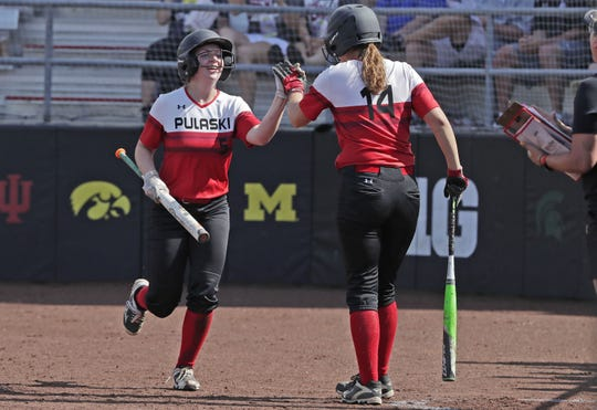 Pulaski's Joshephine Wesoloski (5) is jubilant with Allison Maroszek (14) during the WIAA state softball tournament on Thursday.