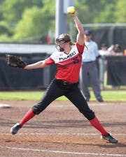 Pulaski's Lauren Dixon (25) winds up a pitch against Wilmot Union.