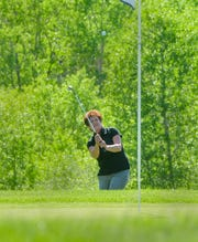 Cyndy Howg chips onto the green at Marias Valley Golf Course, Tuesday afternoon.  Howg and her husband Merlyn are from southern Alberta, Canada and enjoy coming down to Shelby for golf vacations at Marias Valley.