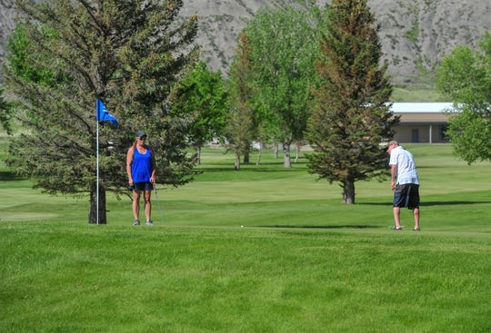 Danelle Burns and Wade Welker play a practice round before their golf league on Tuesday afternoon at Marias Valley Golf Course in Shelby on Tuesday.