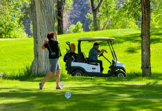 Cyndy Howg tees off on hole 11 at Marias Valley Golf Course, Tuesday afternoon.  Howg and her husband Merlyn are from southern Alberta, Canada and enjoy traveling to Shelby for golf vacations at Marias Valley.