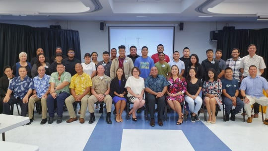 Student recruits, Guam Community College representatives, Cabras Marine Corp. representatives and dignitaries pose for a photo after the official launch of the GCC Ship Repair Transportation Boot Camp on June 3 at the college's Multi-purpose Auditorium.
