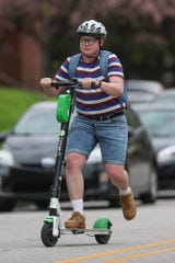 Lo Ray rides a Lime scooter on a commute on May 1, 2019.