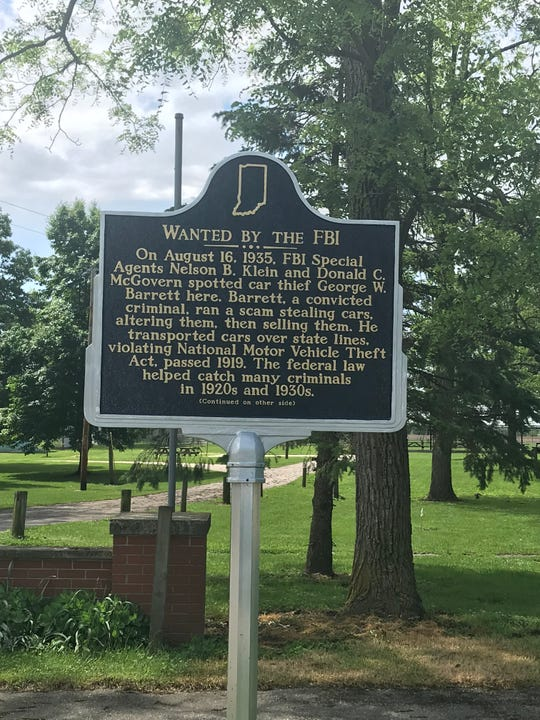 Front of historical marker telling the story of an FBI arrest in College Corner.