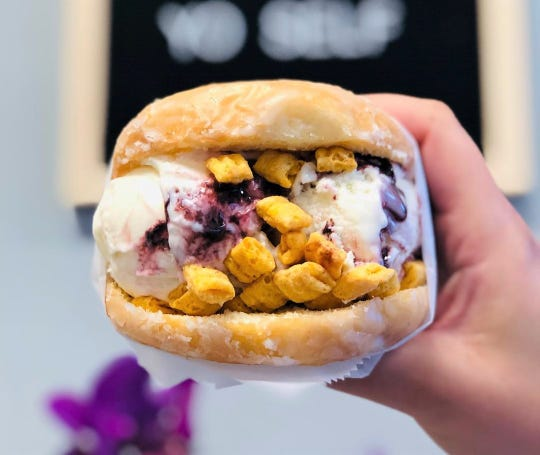 TeeJay's Sweet Tooth on Indianapolis' north side boasts 16 rotating ice cream flavors that may be stuffed inside glazed doughnuts and hit with various toppings including breakfast cereal.