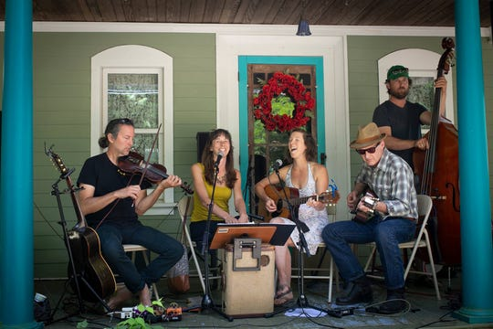 From left, Steve Selin, Emily Thompson, Lauren McKinzey, Stefan Senders and Paul Martin enjoy a Saturday afternoon performing at a Trumansburg Porchfest.