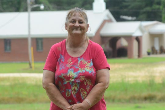 Kathy Wood stands in front of Gum Springs Baptist Church in Braxton, Mississippi, on June 6, 2019. Wood said the Rev. Harry Gipson used to preach at the church.