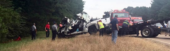 In this photo provided by The Macon Beacon, authorities remove one of several vehicles involved in a fatal crash Wednesday, June 5, 2019, near Scooba, Miss., in the same area where a crash took the lives of eight people two days earlier.