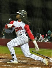 James Beard watches a hit ball during a game in the 2018 season.