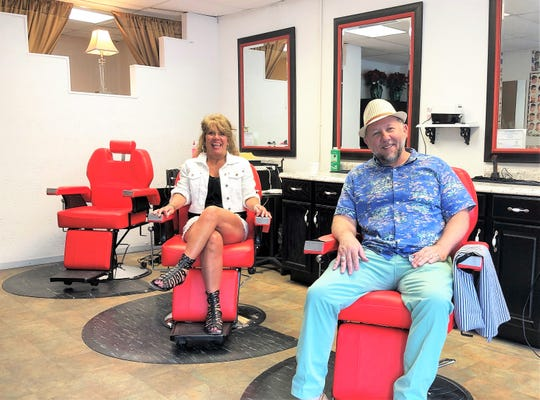 Siblings Tracy Petree and Tony Chapman at the Fountain City Barber Shop opening on June 6, 2019.