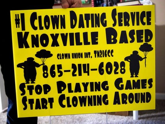 A clown dating service sign Michael Williamson created and placed around Knoxville as part of a marketing campaign for Dismembers Only, an apparel and accessories brand based on dead forms of media, such as VHS tapes.