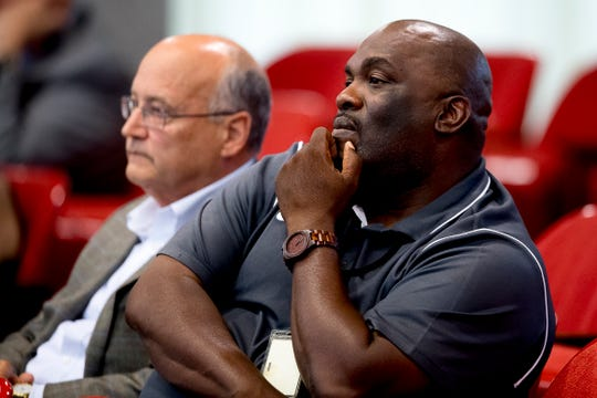 Derrick Folsom, right, and Michael Caudle, from Cherokee Health Systems, listen during a Knox County Commission meeting at the City County Building in Knoxville, Tennessee on Thursday, June 6, 2019.