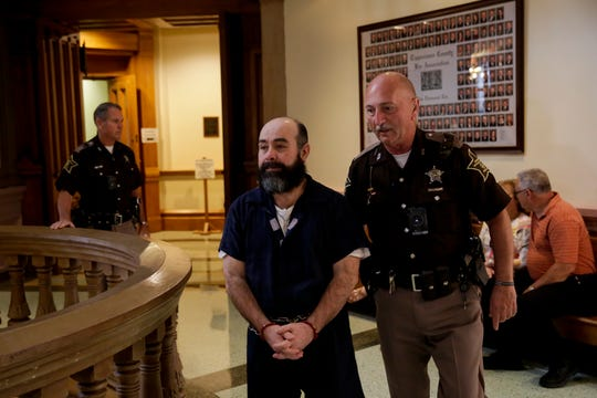 Franco Navarrete is escorted into Superior Court 1 by a Tippecanoe County Sheriff's deputy, Thursday, June 6, 2019, at the Tippecanoe County Courthouse in Lafayette. Judge Randy Williams sentenced Navarrete to 120 years for the 2017 killings of 38-year-old Gustavao Sanchez Campuzano — his wife's brother — and 67-year-old Catalina Campuzano Lujano, who was his wife's mother.