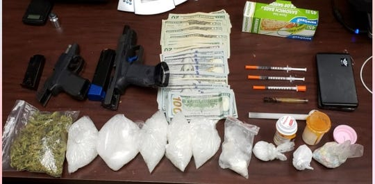 Lafayette Police confiscated drugs, handguns and other illegal items from a Youngsville man.