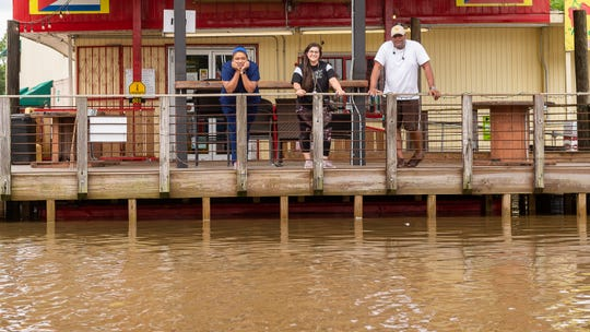 Stranded residents waiting for transportation through the high water at Pepins at the intersection of Ridge Rd and Broussard Rd as heavy rain produces high water across Acadiana. Thursday, June 6, 2019.