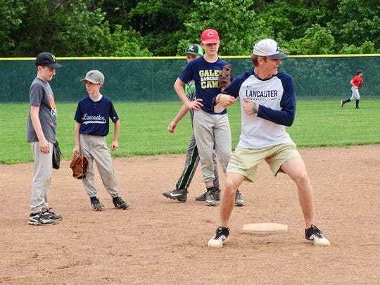 Lancaster junior baseball player Evan Sines giving instructions on how to turn a double play during the Golden Gales Summer Baseball Camp.