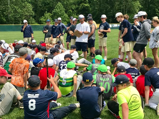 Lancaster baseball coach Corey Conn talks with campers during the Golden Gales Summer Baseball Camp. More than 130 campers participated.