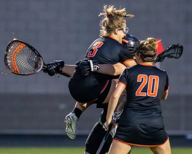 Makenna Wiljanen leaps into the arms of goalie Elizabeth Kelley to celebrate Brighton's 12-10 state semifinal lacrosse victory over Hartland on Wednesday June 5, 2019.