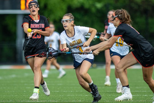 Hartland's Tessa Chuba (3) chases a loose ball in a state semifinal lacrosse game against Brighton on Wednesday, June 5, 2019.