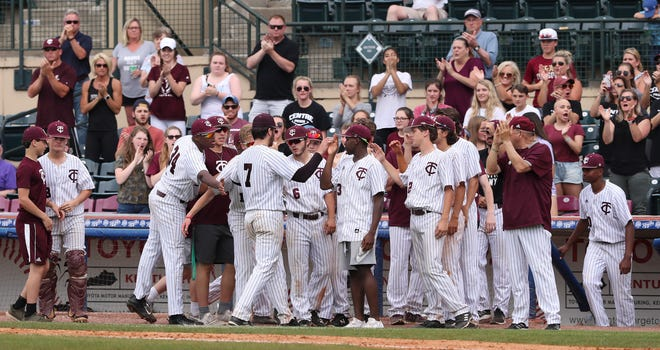 Tates Creek pitcher Konnor Lewis (7) was greeted by teammates as he was relieved in the 7th inning against PRP during the quarterfinals of the KHSAA state baseball tournament in Lexington.  Tates Creek won 3-2.June 6, 2019
