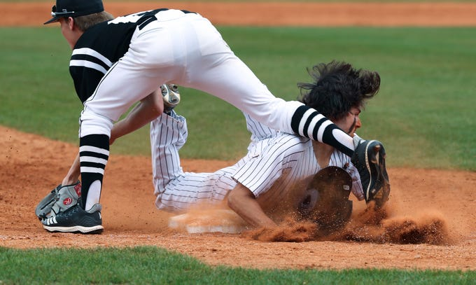 Tates CreekÕs Griffin Prince (4) slides safely into third against PRPÕs Matt Creech (6) during the quarterfinals of the KHSAA state baseball tournament in Lexington.  Tates Creek won 3-2.